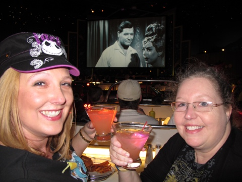 Goofy girls with glowing cocktails at the SciFi Dine In Theater